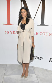 Designer Rachel Roy accessorized her look with snakeskin stilettos.