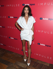 Shanina Shaik complemented her dress with a pair of bowed white pumps.