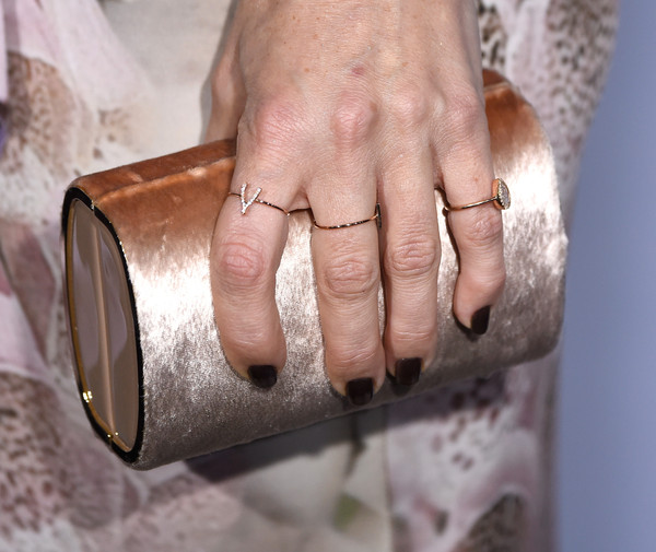 Kate Hudson wore a cute diamond wishbone ring by Jennifer Meyer.