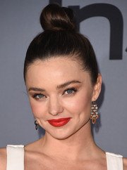 Miranda Kerr brightened up her look with a swipe of red lipstick.