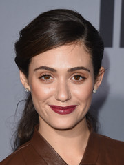 Emmy Rossum added a bold pop with a swipe of raspberry lipstick.