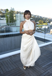 Kat Graham was summer-glam in an ivory halter crop-top at the InStyle Badass Women dinner.