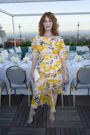 Christina Hendricks punctuated her florals with a simple white box clutch.