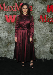 Camila Mendes chose a long-sleeve burgundy shirtdress for the InStyle Max Mara Women in Film celebration.