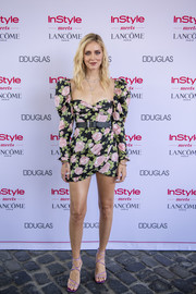 Chiara Ferragni went the flirty route in a floral mini dress with leg-of-mutton sleeves at the InStyle Meets Lancome Paris x Chiara Ferragni event.