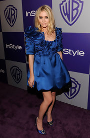 Ashley wore an intricate petal-detailed, blue Fall 2009 cocktail dress with a cute bubble hem.