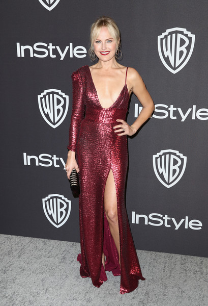 Malin Akerman looked provocative in an asymmetrical wine-red sequined gown with a plunging neckline and a thigh-high slit at the InStyle and Warner Bros. Golden Globes after-party.