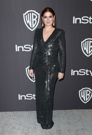 Debra Messing sparkled in a gunmetal sequined gown at the InStyle and Warner Bros. Golden Globes after-party.