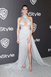 Heidi Klum looked va-va-voom in a gray Paolo Sebastian gown with a cleavage-baring cutout at the InStyle and Warner Bros. Golden Globes after-party.