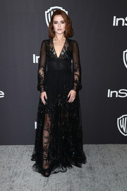 Zoey Deutch looked diva-glam in a black Valentino gown with sequin detailing at the InStyle and Warner Bros. Golden Globes after-party.