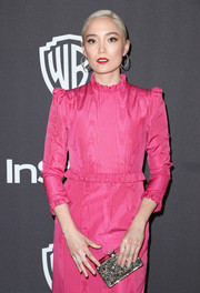 Pom Klementieff paired a glittering box clutch with a fuchsia dress for the InStyle and Warner Bros. Golden Globes after-party.