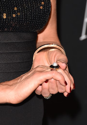 Jennifer Aniston attended the InStyle and Warner Bros. Golden Globes party wearing a classic pearl ring.