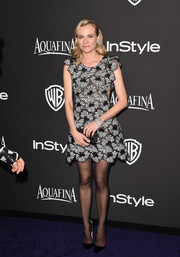 Diane Kruger looked vibrant and feminine in a monochrome floral-embroidered mini dress by Giamba at the InStyle and Warner Bros. Golden Globes party.