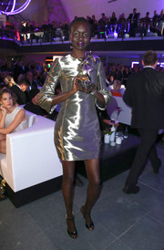 Alek Wek went for high shine with this metallic-green mini at the InTouch Awards.