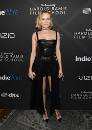 Diane Kruger sealed off her chic ensemble with black T-strap pumps by Christian Louboutin.
