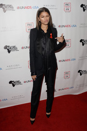Zendaya Coleman went for a sleek menswear-inspired look in a black tuxedo teamed with a silk blouse at the Inaugural World AIDS Day benefit.