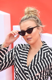 Tallia Storm sported a messy top knot at the UK premiere of 'Incredibles 2.'