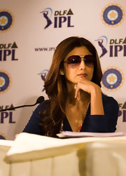 Shilpa Shetty hid her poker face with the aid of stylish aviator sunglasses at the Indian Premier League Auction.