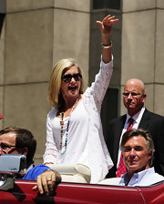 Olivia Newton-John roamed around Indianapolis in a motorcade wearing a white tank-top and a lace cardigan.