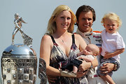 Susie Wheldon wore a cross pendant during this Indi 500 photo shoot with husband Dan Wheldon.