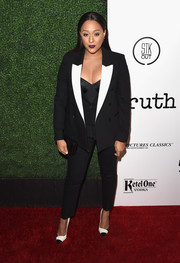 Tia Mowry went for an ambisexual vibe in a black-and-white Neil Barrett pantsuit when she attended the screening of 'Truth.'