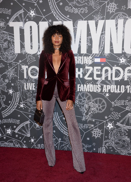 Indya Moore Box Clutch [fashion,carpet,red carpet,premiere,fashion design,leg,flooring,style,formal wear,performance,tommynow,front row,atmosphere,front row atmosphere,tommynow new york,new york,the apollo theater,indya moore]