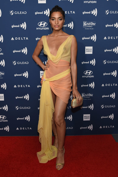 Indya Moore Metallic Clutch [shoulder,red carpet,clothing,fashion model,dress,carpet,cocktail dress,fashion,joint,premiere,glaad media awards,new york,new york hilton midtown,arrivals,indya moore]