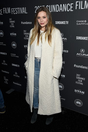 Elizabeth Olsen layered a white Sportmax coat over a shirt and blue jeans for the Sundance premiere of 'Ingrid Goes West.'