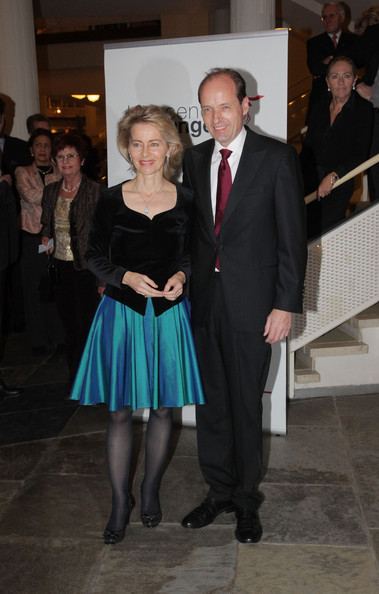 Ursula shakes up the evening look with a bright knee-length skirt topped by a sleek velvet jacket.