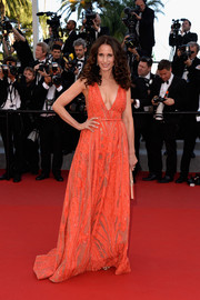 Andie MacDowell was glam with a hint of sexiness in a patterned red Elie Saab gown with a plunging neckline during the 'Inside Out' premiere in Cannes.