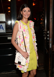 Giovanna Battaglia attended the Tribeca Film Festival Artists Dinner carrying a chic white Chanel chain-strap bag.