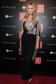 Ivanka Trump made a tres chic statement in a caped gray one-shoulder blouse during the InStyle 20th anniversary party.