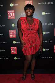 Danielle Brooks put her voluptuous figure on display in a tight-fitting red tribal-print mini during the InStyle 20th anniversary party.