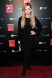 Abigail Breslin was all covered up in a long-sleeve LBD and thigh-high lace-up boots during the InStyle 20th anniversary party.
