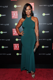 Garcelle Beauvais sheathed her curves in a body-con teal evening dress for the InStyle 20th anniversary party.