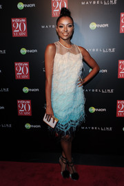 Kat Graham went for a flapper-girl vibe in a feather-embellished ombre shift dress by Lela Rose during the InStyle 20th anniversary party.