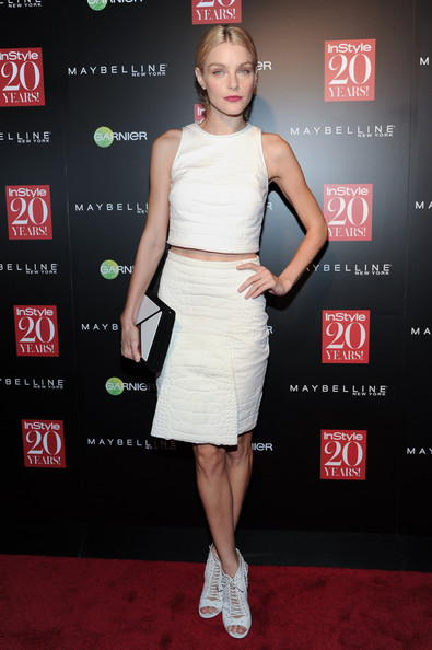 Jessica Stam completed her cool outfit with a matching white croc-embossed pencil skirt.