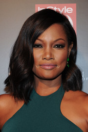Garcelle Beauvais was chicly coiffed with this side-parted wavy 'do at the InStyle 20th anniversary party.