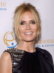 Heidi Klum sported a messy-sexy loose ponytail at the International Centre for Missing and Exploited Children's Inaugural Gala.