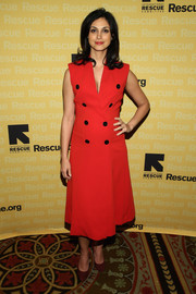 Morena Baccarin's baby bump was barely visible beneath her stylish red coat dress at the Freedom Award benefit.
