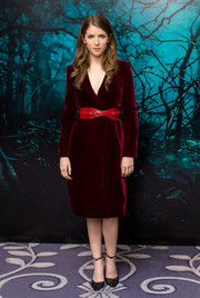 Anna Kendrick oozed sophistication in a red velvet wrap dress by Oscar de la Renta during the 'Into the Woods' photocall.