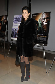 Gina Gershon's gray Christian Louboutin boots and black fur coat at the premiere of 'The Intouchables' were an ultra-chic pairing.