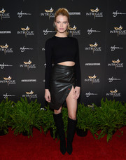 For her footwear, Hailey Clauson chose a pair of black knee-high boots.