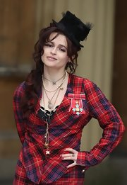 Helena Bonham Carter accented her look with scarlet nail polish for an investiture ceremony at Buckingham Palace.