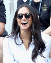 Meghan Markle kept the sun out with a pair of tortoiseshell shades.