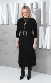 Elisabeth Moss opted for a simple black sweater dress when she attended the 'Invisible Man' photocall in London.