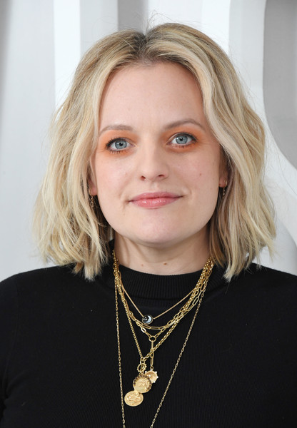 Elisabeth Moss made her eyes pop with a heavy application of orange shadow.