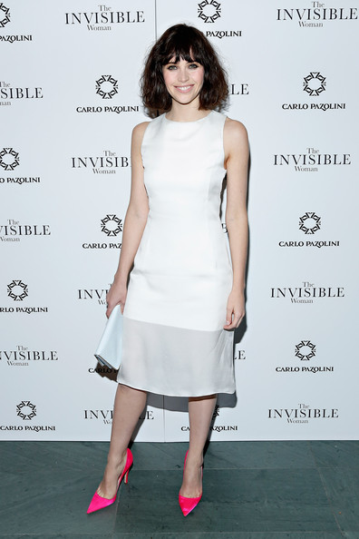 A pair of neon-pink Christian Dior pumps provided a welcome pop of color to Felicity Jones' look.
