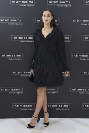 Irina Shayk chose a semi-sheer Givenchy LBD with a ruffled neckline and a layered hem for the Intimissimi 20th anniversary event.