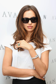Irina Shayk hid her eyes behind a pair of dark wayfarers as she posed for photographers at the Avakian Suite.